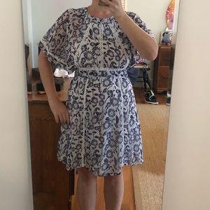 Fun as flirty open back dress